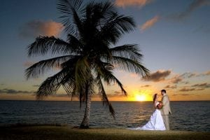 "Say ""I Do"" against the glowing backdrop of a beautiful Barbados sunset."