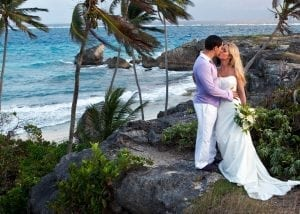 Promise forever on the brow of a natural, rugged Barbados sea cliff, with panoramic ocean views.