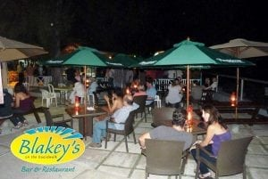 Enjoy a candlelit dinner with a view of the south coast beach at Blakey's.