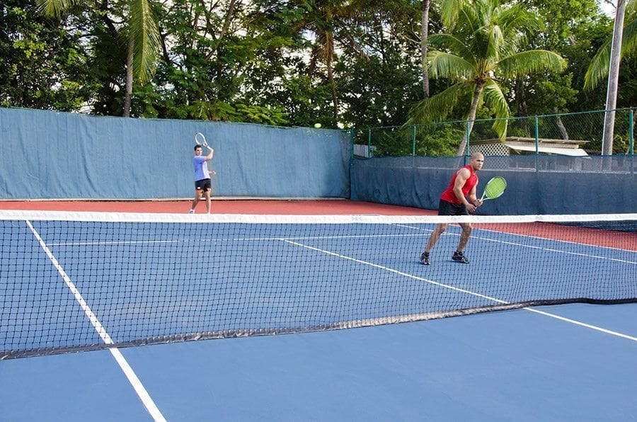 Unwind with a game of tennis at Bougainvillea Beach Resort.