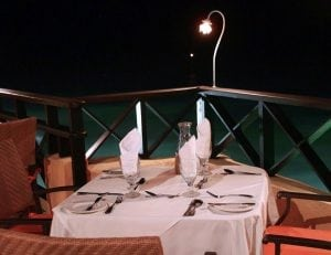 Honeymoon at Champers Restaurant & Wine Bar with a table for two at the waters edge.