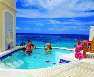 Relaxing in a pool overlooking the ocean at the Crane Resort in Barbados.