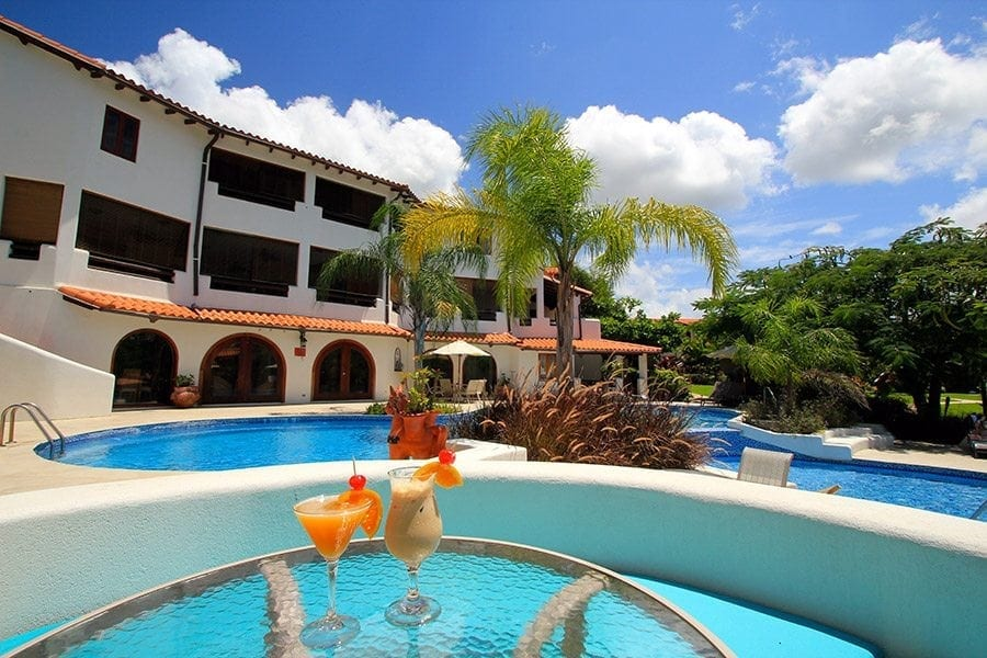 Relax by the Pool at Sugar Cane Club Hotel.