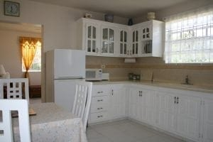 Spacious kitchen at Miri-Joy Apartments Barbados - fully equipped with all utensils and appliances.