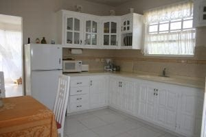 Miri-Joy Apartments Barbados - kitchen fully equipped with all utensils.