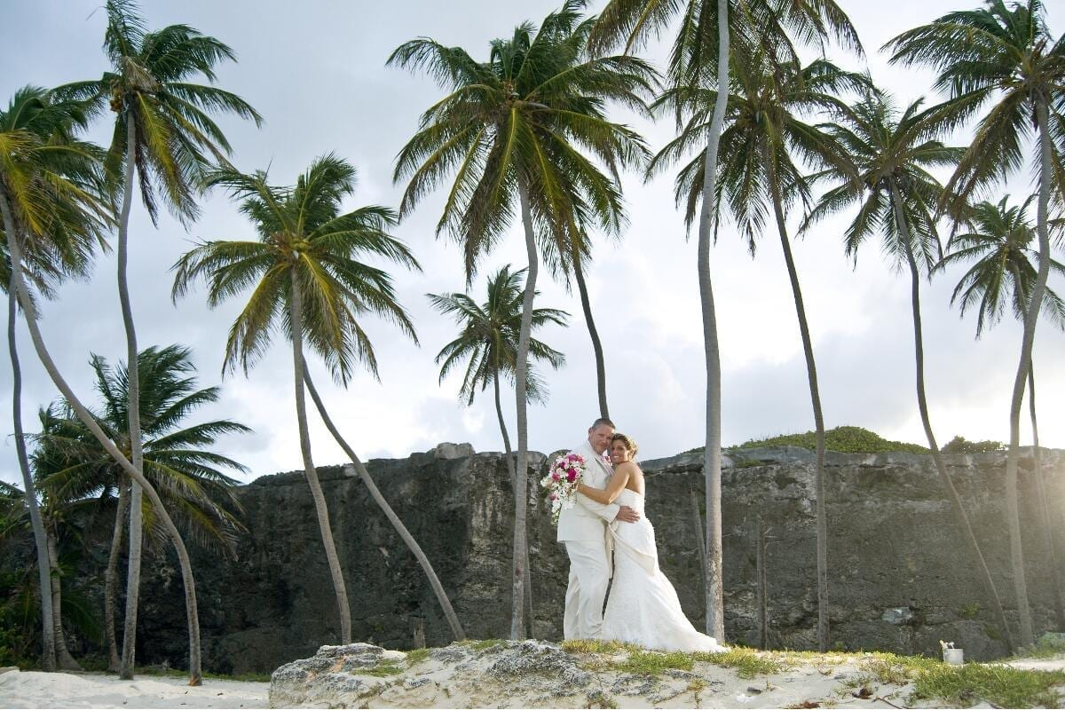 "Say a tropical ""I do"" beneath the palm trees on a beautiful Barbados beach."