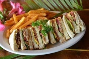 Lucky Horseshoe Barbados Club Sandwich: A triple decker served with chicken, bacon, cheese, lettuce & tomato.