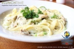 Lucky Horseshoe Barbados Chicken Pasta: Fettuccine, onions, peppers with chicken in a garlic cream sauce topped with fresh Parmesan.