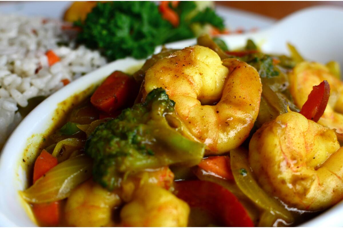 Lucky Horseshoe Barbados Coconut Curry Shrimp : Shrimp sauteed in a coconut and Curry sauce, served with rice and seasonal vegetables.