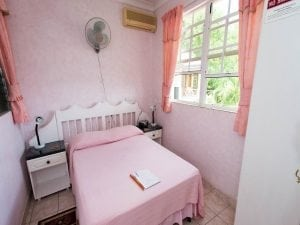 Pink Room at Palm Paradise Guest House.