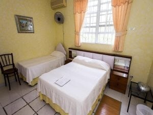 Yellow Room at Palm Paradise Guest House.