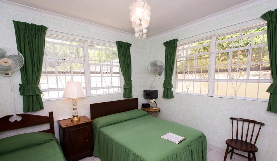 Green Bedroom at Palm Paradise Guest House.