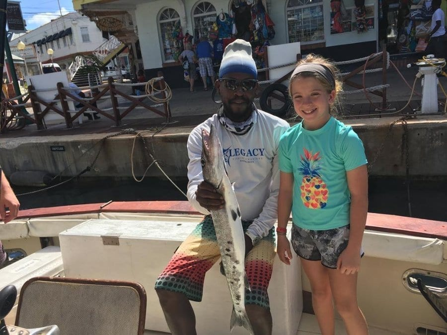 Happy Little Lady with catch aboard Legacy Barbados.