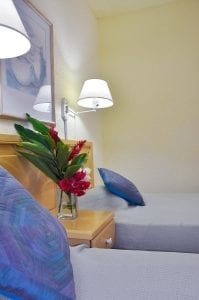 Stay at Plum Tree Club Apartments in a bedroom with single beds.